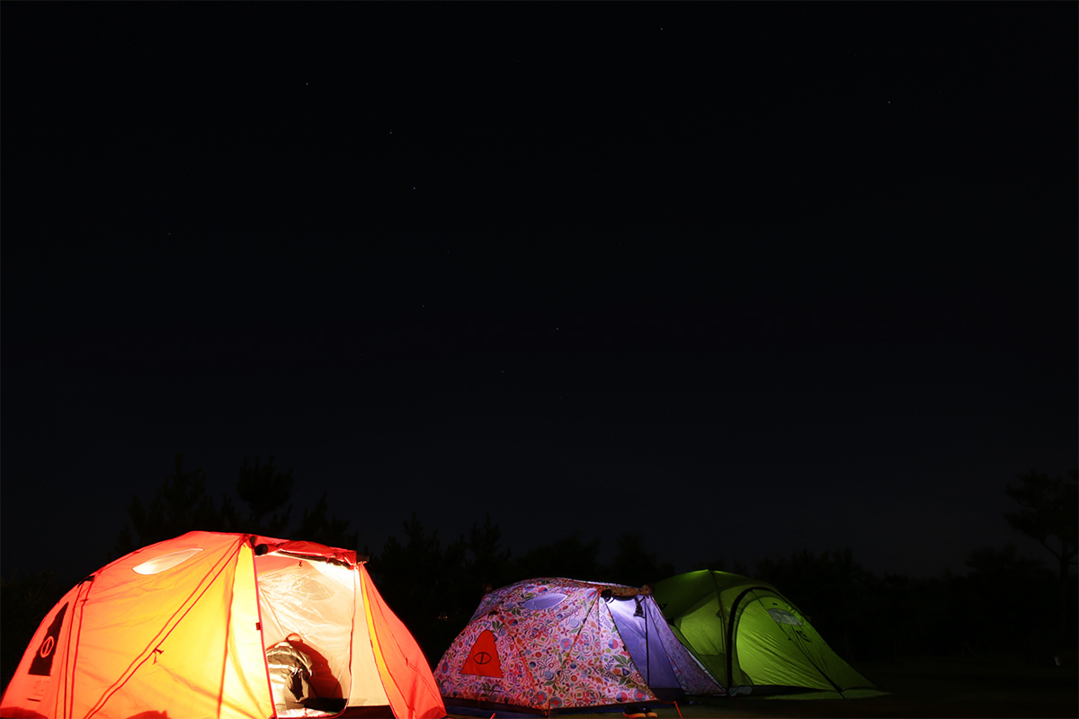 Three tents with Star-filled night sky